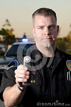 dui-breath-test-police-officer-holds-up-machine-stop-30814058